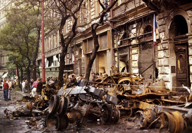 Burnt out and wrecked vehicles piled up in downtown Prague.