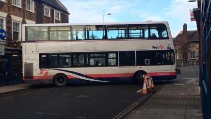 Bus gets stuck down a narrow Norwich street