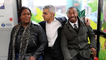 Mayor of London, Sadiq Khan (centre) chats with Jason Bynoe, 42, from Putney (right), and Natasha Joseph, 36, from Wandsworth, during the launch of the capital's first Low Emission Bus Zone, on Putney High Street