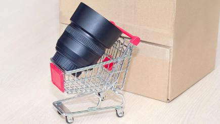 Camera lens in small shopping trolley