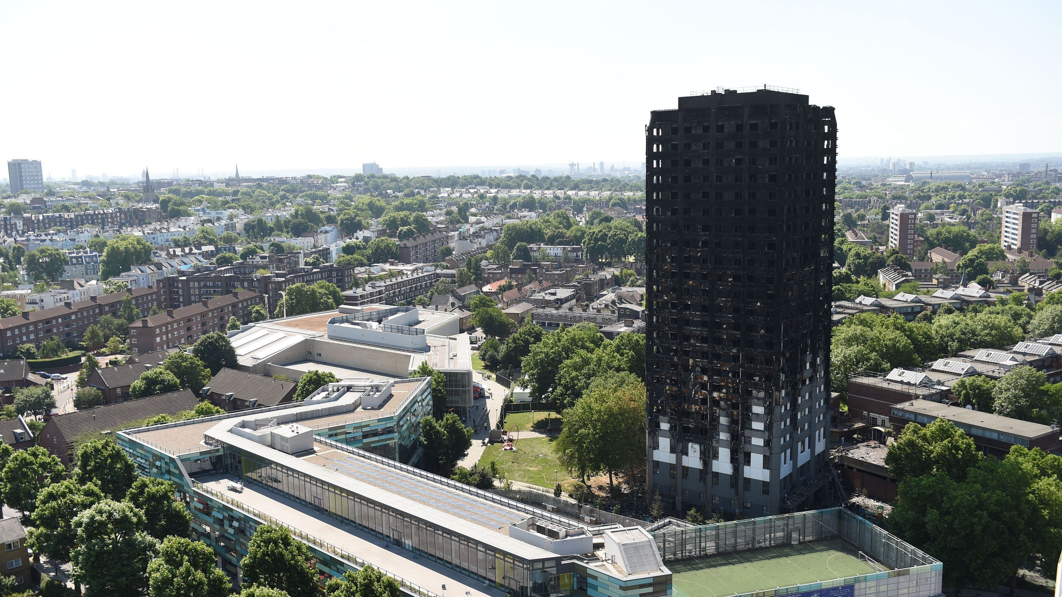 Grenfell Tower fire: May pledges to fund cladding removal