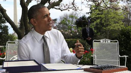 Barach Obama writing out in the garden