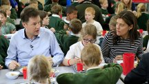 Nick Clegg and his wife eating school lunch with children