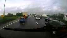 Car clips lorry and bounces across motorway – into path of £50,000 BMW