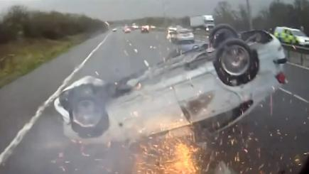 Shocking moment car slides on roof along M5