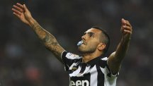Carlos Tevez celebrates with a dummy in his mouth after scoring for Juventus.