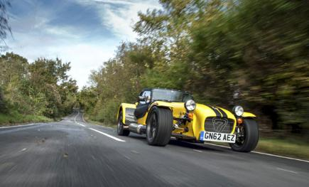 Caterham Seven kit car being driven down a country road