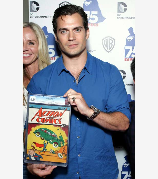Henry Cavill, the latest actor to play Superman, holds a copy of Action Comics 1 valued at almost £2 million.