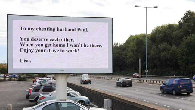 Woman dumps cheating husband with enormous motorway sign - BT