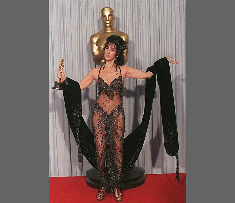 Cher - and her Oscar - looked very happy in 1988. Her glittery dress shows off her toned physique to perfection.