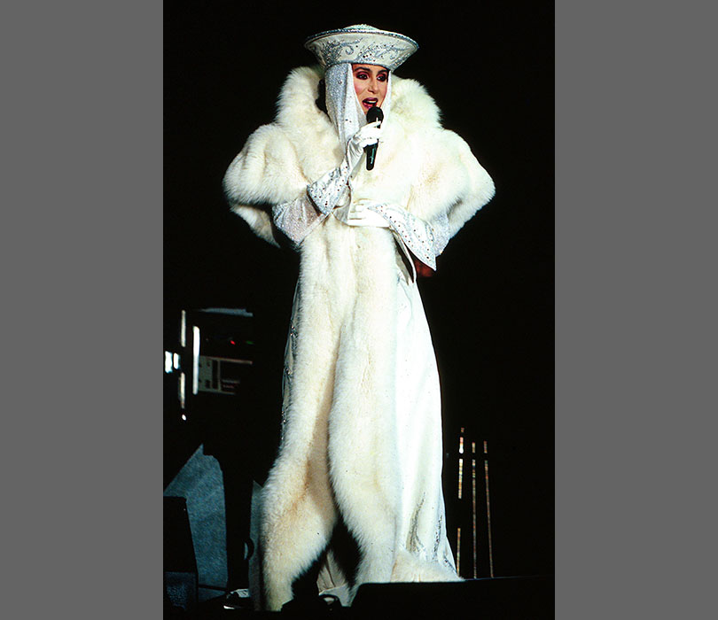 Cher's all wrapped up in concert in 1990.