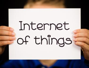 Child holding up Internet of Things sign