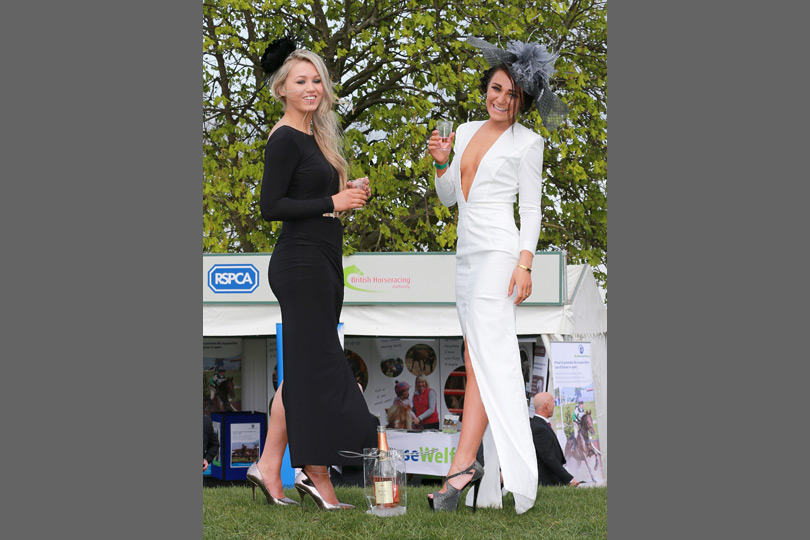 Cleverly coordinated outfits go a long way at Aintree! These ladies give themselves a toast.
