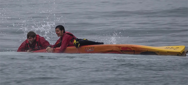 Tom Mustill and Charlotte Kinloch cling onto their upturned kayak after the whale encounter.