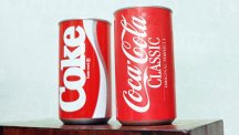 Coca-Cola Classic - Coke's revived formula - alongside a can of the ill-received New Coke.