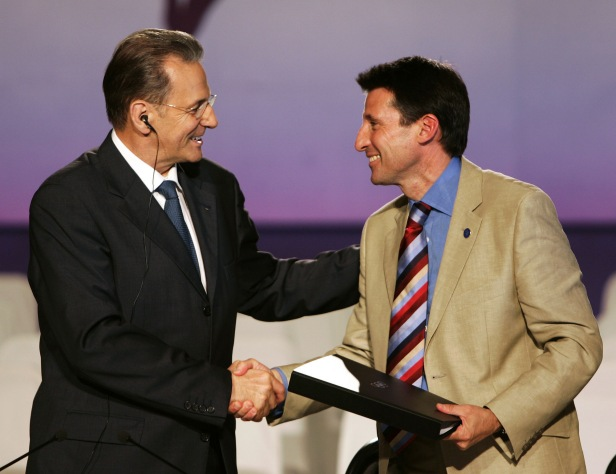 London bid chairman Lord Coe shakes hands with IOC president Jacques Rogge after signing the contract to host the 2012 Olympics.