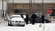 Police investigators work near the Planned Parenthood clinic in Colorado Springs after the deadly shooting (AP)