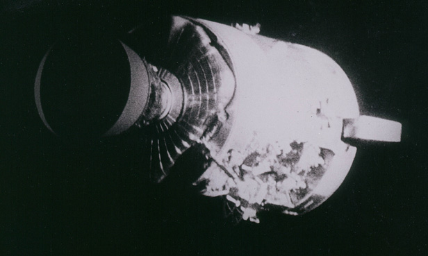 Apollo 13's Command Module showing the damage following the explosion as it separated from the Lunar Module.