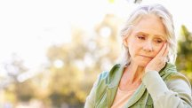 Concerned mature woman deep in thought