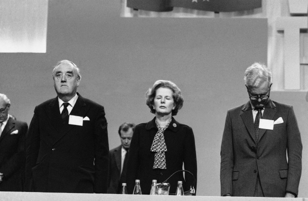 Margaret Thatcher, flanked by William Whitelaw and Douglas Hurd, stands in prayer at the start of the conference's final day.