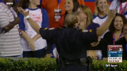 Screengrab of  a US police officer who caught a missed pass in a football game and claimed a 'touchdown'.