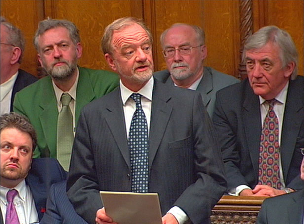 Robin Cook delivers his speech - future Labour leader Jeremy Corbyn sits behind him.