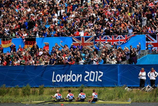 The men's coxless four celebrate in front of the crowds at Eton Dorney.