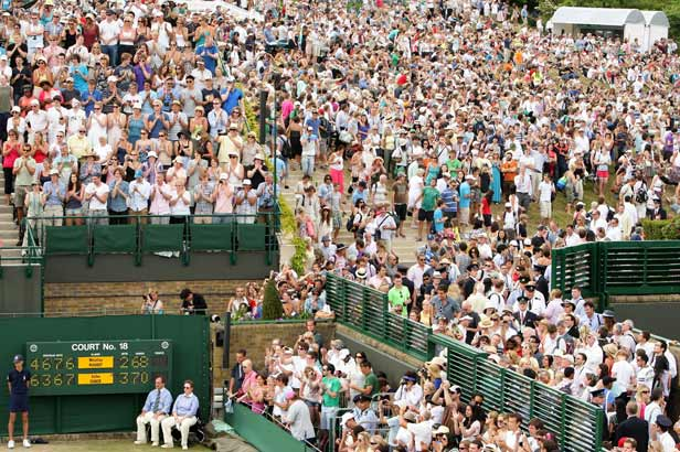 Crowds on Henman Hill and on Wimbledon's walkways watch the conclusion of the match.