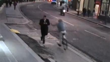 Cyclist snatches phone from pedestrian