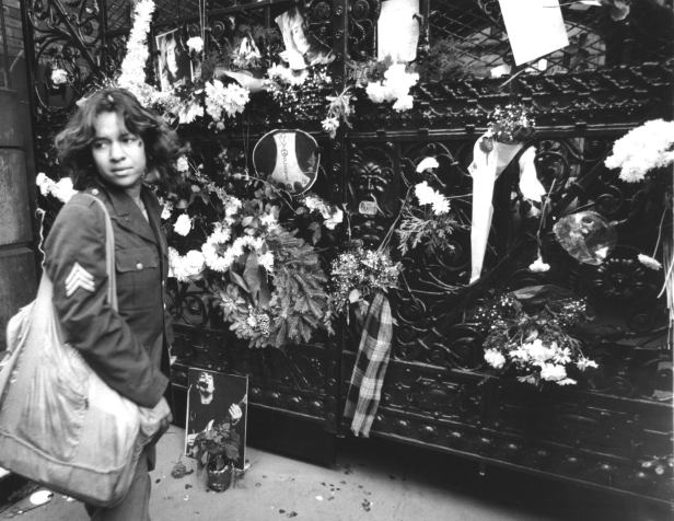 Fans mourn John Lennon outside his Dakota Building apartment