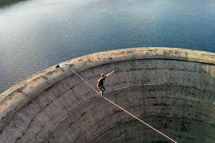 wire walker crosses 200ft deep reservoir drain  u2013 video bt