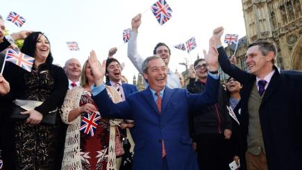 Ukip leader Nigel Farage greets his supporters on College Green in Westminster