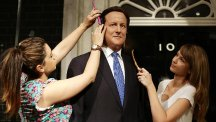Caryn Mitman and Clare Galvin put the finishing touches to a refresh of Prime Minister David Cameron's wax figure at Madame Tussaud's in London, five years after its original inclusion and ahead of the Queen's Speech. (PA)