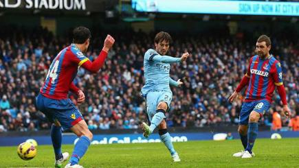David Silva scores one of his two goals for Manchester City against Crystal Palace.