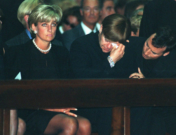 Princess Diana, Elton John and David Furnish at Versace's memorial mass in Milan.