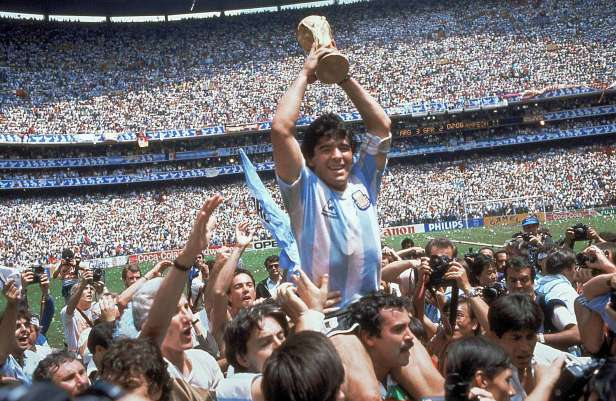 Diego Maradona lifts the World Cup after Argentina beat Germany 3-2 in 1986.