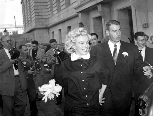 Marilyn and second husband Joe DiMaggio on their wedding day in 1954.