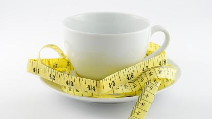 Coffee cup being measured