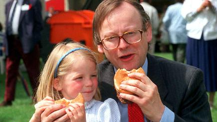 John Gummer and daughter Cordelia eating British beef burgers to prove the safety of the meat.