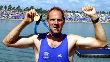 Steve Redgrave celebrates GB's coxless four victory in 2000.