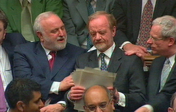 MPs Frank Dobson and Chris Smith congratulate Cook as he sits down following his resignation speech.