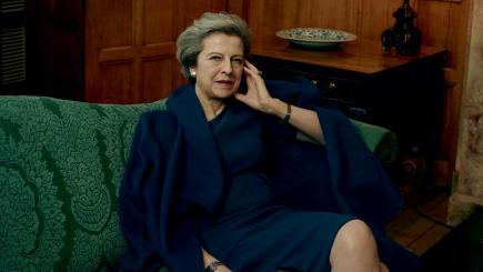 Theresa May wearing an LK Bennett coat and dress as she was photographed by Annie Leibovitz for American Vogue (American Vogue)