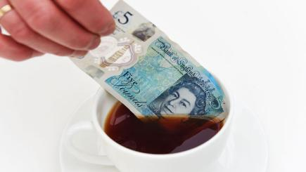 New £5 note being dipped into a hot drink