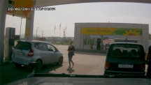 Driver walking back to car at petrol station