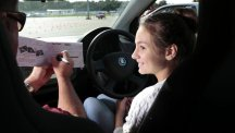 A young girl behind the wheel at a Young Driver training session