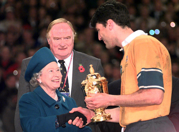 The Queen presents Australian Rugby Union captain John Eales with the William Webb Ellis trophy in Cardiff just hours after the referendum result had been revealed.