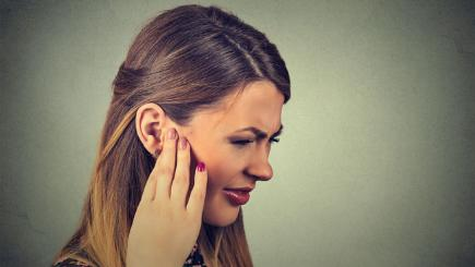 Woman with ear pain