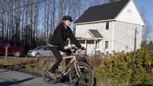 Nurse Kaci Hickox rides away from the home she is staying in at Fort Kent, Maine. (AP)