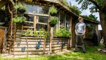 Joel Bird next to his Allotment Roof Shed, which has taken the title of Shed Of The Year.