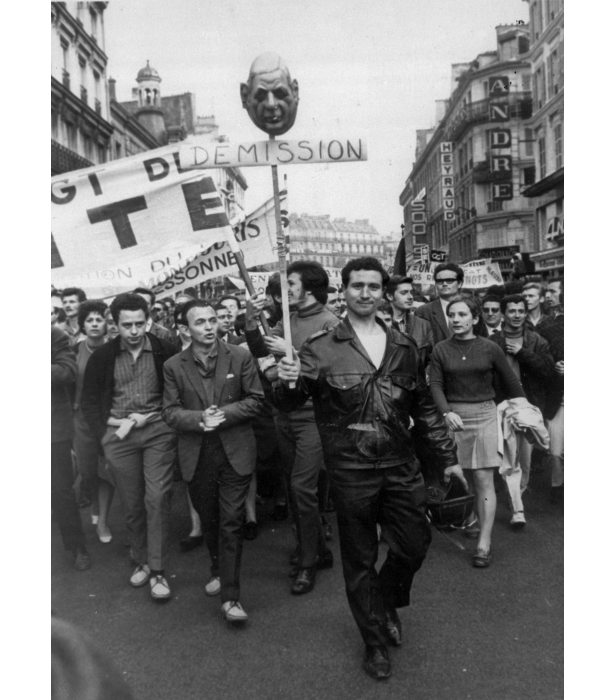A demonstrator carries an effigy of De Gaulle's head with the word 'resignation' during a union parade held in Paris on May 29, 1968.